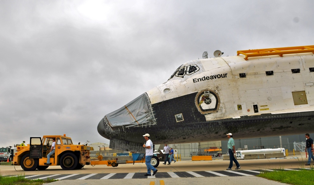 Space Shuttle Endeavour leaves the Orbiter Processing Facility on its way to the Vehicle Assembly Building (VAB) at Kennedy Space Center August 11, 2011 in Cape Canaveral, Florida. The shuttle's departure to L.A. has been postponed due to weather.