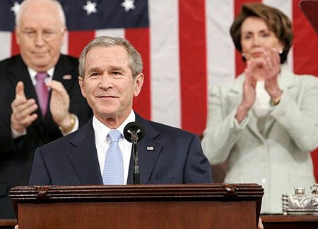 President Barack Obama, flanked by Vice President Joe Biden (L) and Speaker of the House John Boehner (R-OH) delivers his State of the Union address on January 24, 2012 in Washington, DC.