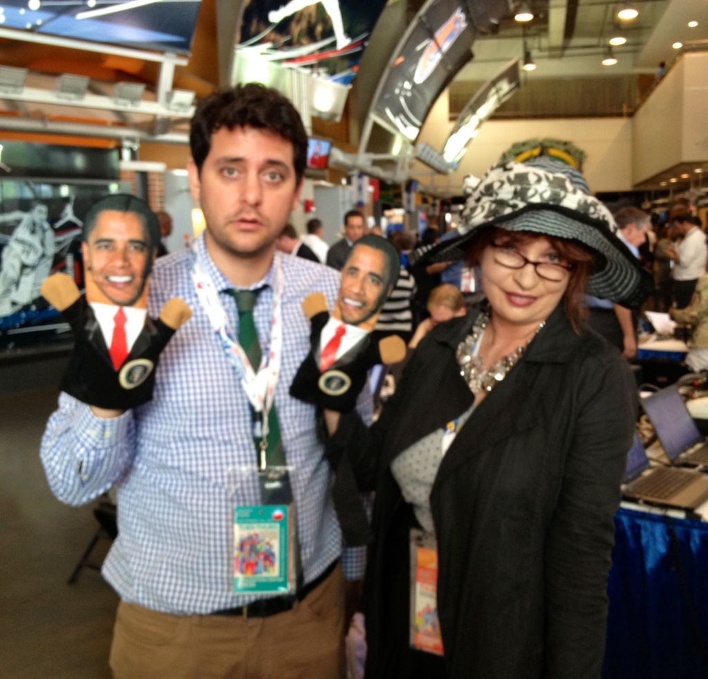 Comedian Ben Bleib and KPCC's Patt Morrison show off some DNC schwag while in Charlotte, North Carolina.