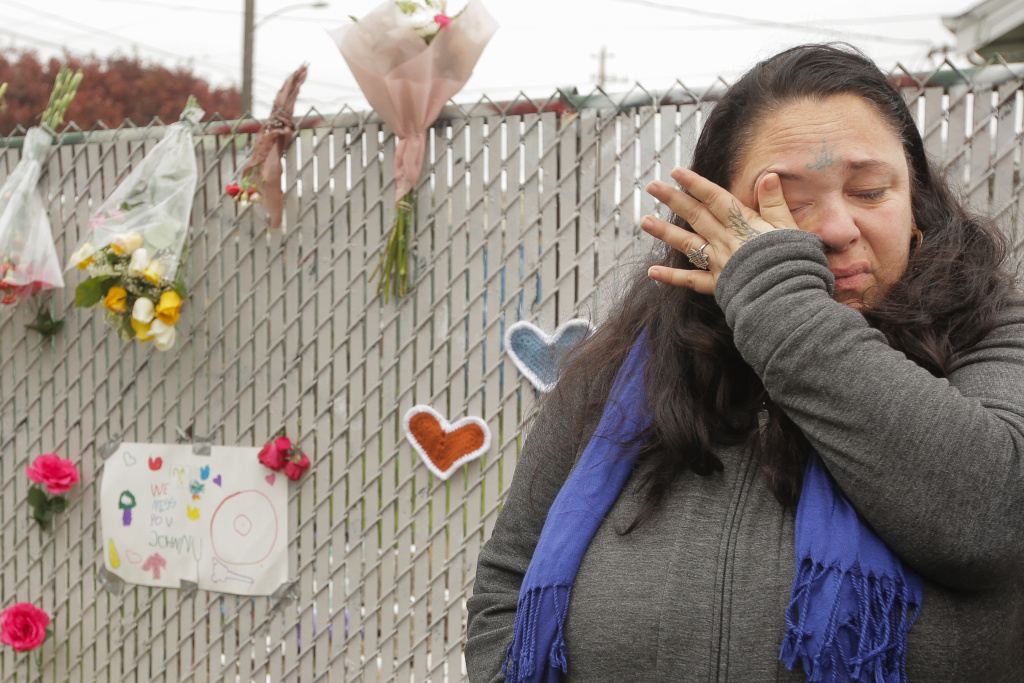 Danielle Boudreaux, who knew the man who rented out the Ghost Ship warehouse for parties, cries by a makeshift memorial near the site of a warehouse fire that claimed the lives of 36 people on December 2, 2016 in Oakland, California.