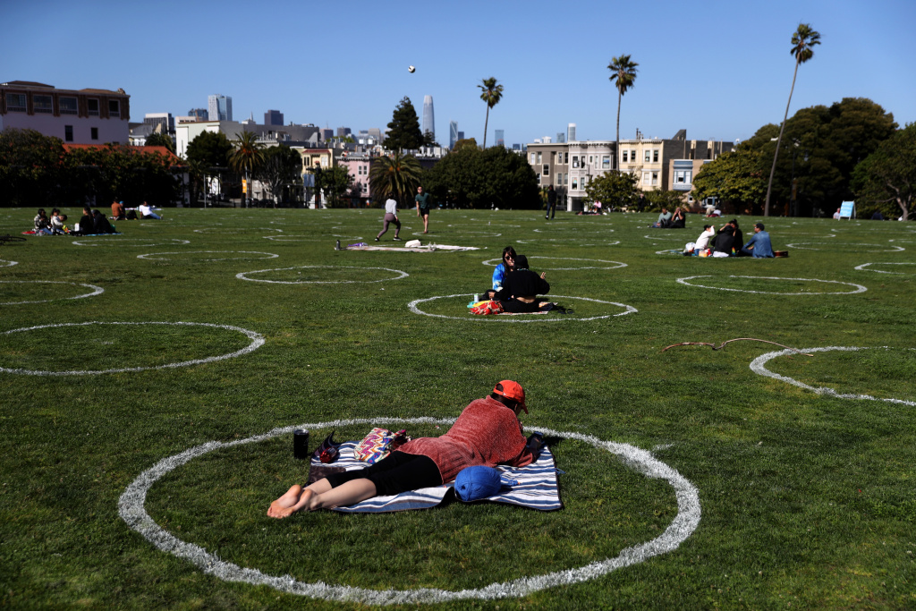 People sit in social distancing circles at Dolores Park on May 20, 2020 in San Francisco, California.