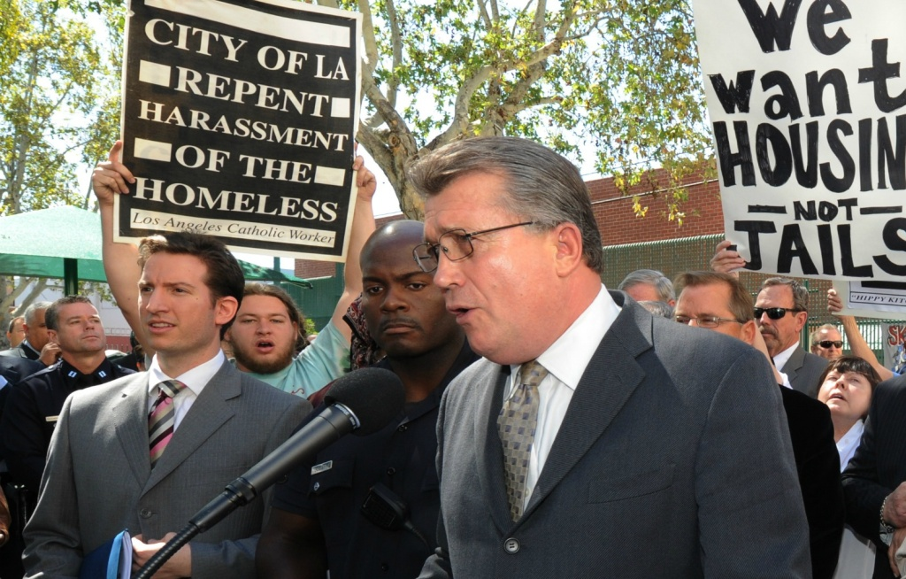 In this file photo, Skid Row activists surround Los Angeles City Attorney Carmen Trutanich.