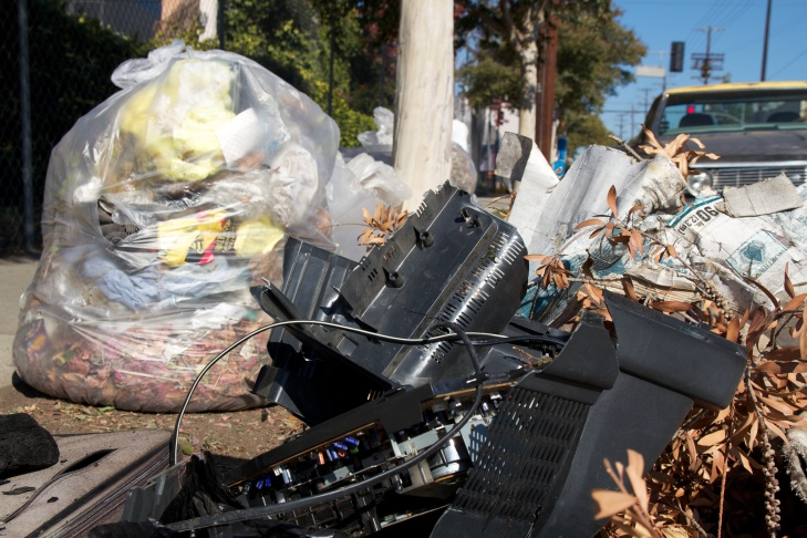 Karl Scott (R) helps General Dogon (L) shovel leaves into a trash bag. Dogon said that among other debris, he found broken beer bottles and empty marijuana vials.