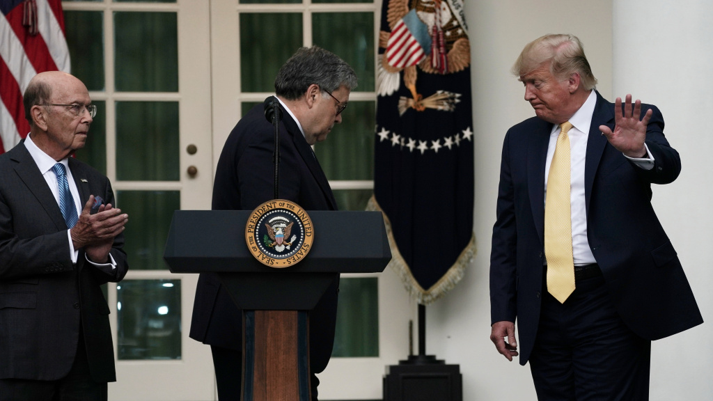 President Trump departs a July 2019 press conference on the census with U.S. Attorney General William Barr (center) and Commerce Secretary Wilbur Ross in the White House Rose Garden.