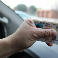 "The new AB 60 driver's licenses are marked with the words ""Federal Limits Apply."" More than 25,000 immigrants without legal status in the U.S. have already received California licenses under the new law."