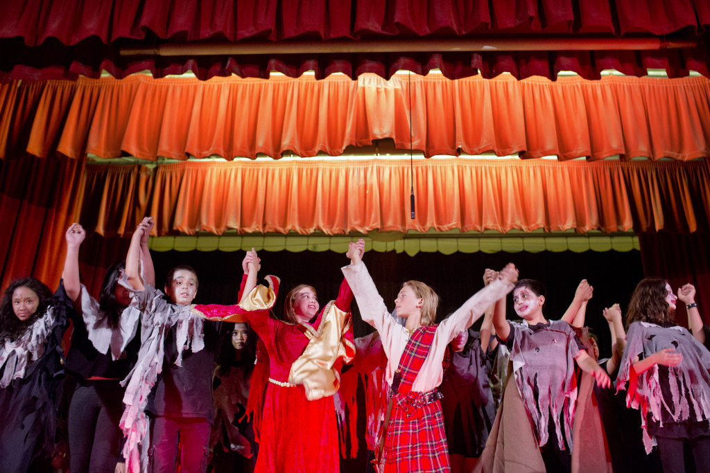 File photo. Sixth-graders at Eagle Rock Elementary School take a bow after performing a zombie version of Shakespeare's Macbeth.
