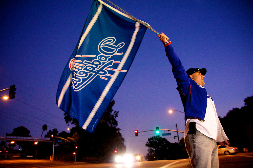 File: Stanley Alvarez (West Covina, CA) waves a Dodgers flag.