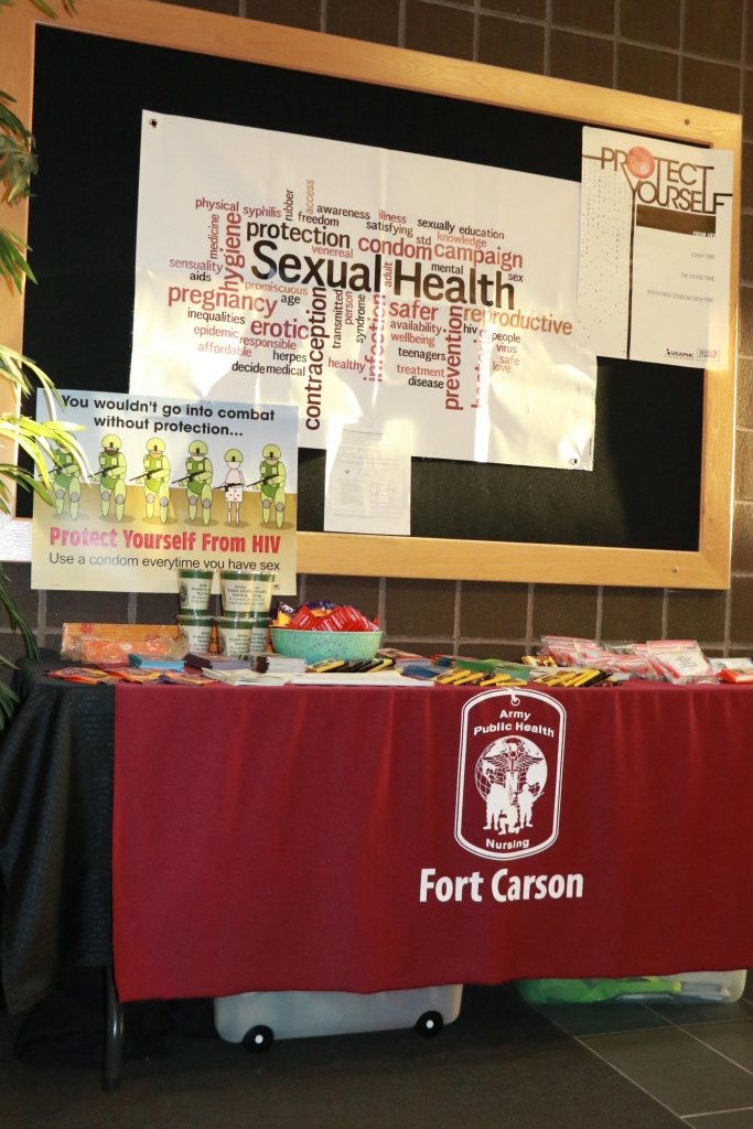 An STI prevention display at Fort Carson, Col. contained information pamphlets, male and female condoms, and contact information to receive free, confidential STI testing.