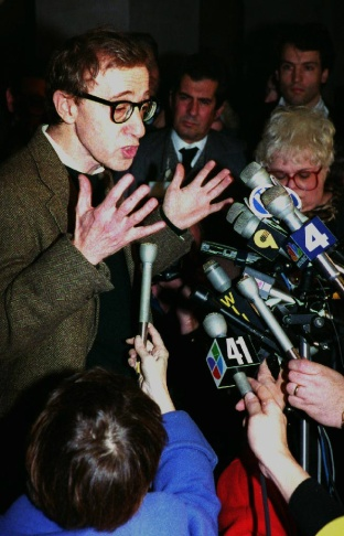 Director Woody Allen faces reporters briefly in New York, June 7, 1993, following a judge's ruling ending his attempt to gain custody of children Moses, Dylan and Satchel. The ruling followed a bitter custody battle with former lover actress Mia Farrow.