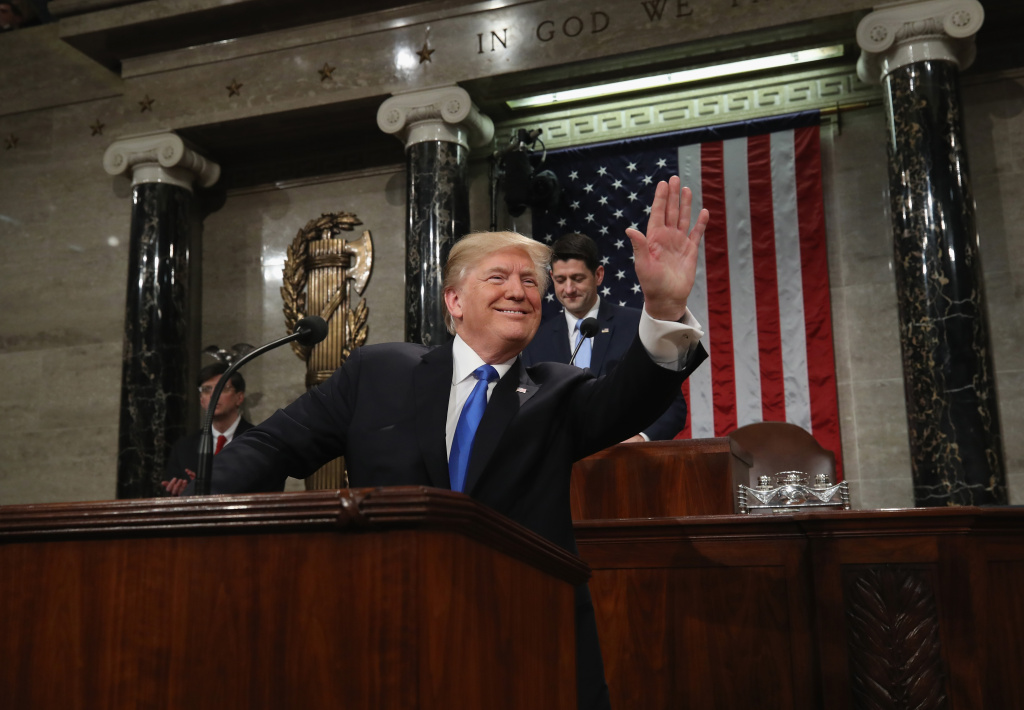 File: President Donald J. Trump waves as he arrives during the State of the Union address in the chamber of the U.S. House of Representatives on Jan. 30, 2018 in Washington, D.C. This is the first State of the Union address given by U.S. President Donald Trump and his second joint-session address to Congress.