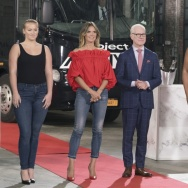 Heidi Klum and Tim Gunn pose with some of the models working in the 16th season of Lifetime's Project Runway.