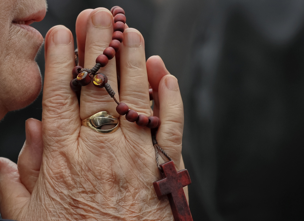 A Catholic worshiper prays during a pilgrimage with Pope John Paul II's remains, in Bucharest, Romania.