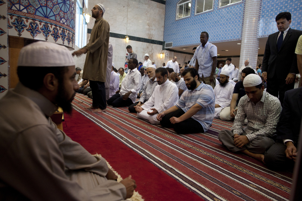 Imam Abdul Karem, left, leading a prayer at the King Fahad Mosque in Culver City.