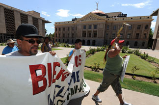 File photo: Protesters march past the Arizona State Capital Building as they campaign against the controversial state law SB1070 which criminalizes illegal immigration, two days before it takes effect, in Phoenix on July 27, 2010.