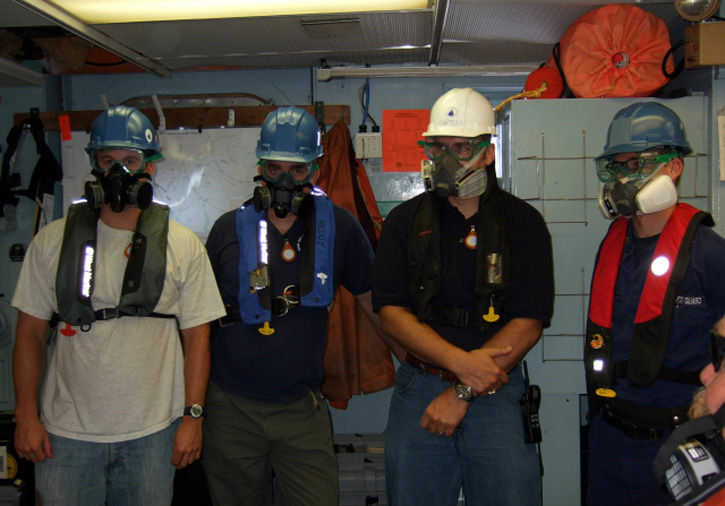 Crew members in the Gulf periodically need to take extraordinary safety precautions from the hydrocarbon fumes in the air. Sean Sylva, Chris Reddy, Rich Camilli, and Lt. Jarrett Parker (USCG) were getting ready to  deploy the autonomous underwater vehicle (AUV) Sentry in the Gulf of Mexico.