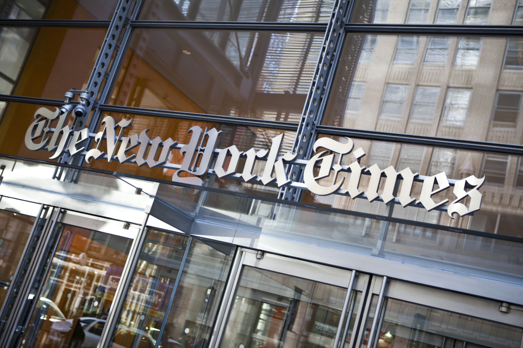 The New York Times logo is seen on the headquarters in New York City. How much longer does the newspaper of record have left?