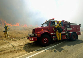 Cal Fire firefighters battle the Crown Fire on July 30, 2010 in the hills above Palmdale, California.