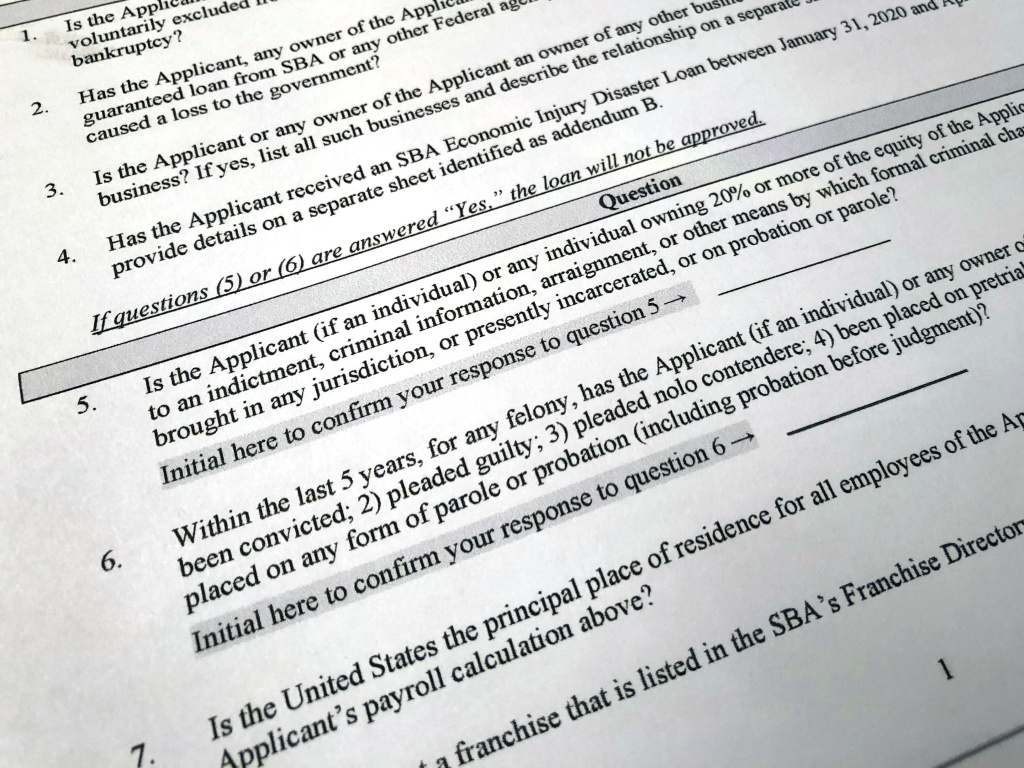 The Justice Department has accused 57 people of defrauding the Paycheck Protection Program. A portion of the program's application is shown here.