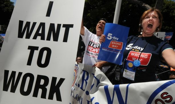 Americans hold up 'I want to work' placards as they join a protest of several thousand people demanding jobs outside City Hall in Los Angeles on August 13, 2010. A Labor Department report showed 131,000 jobs were lost in July and the unemployment rate remained stuck at 9.5 percent.