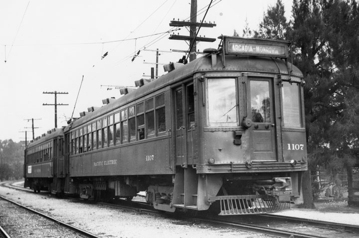 A double-long Pacific Electric Railway car travels on the Arcadia-Monrovia Line.