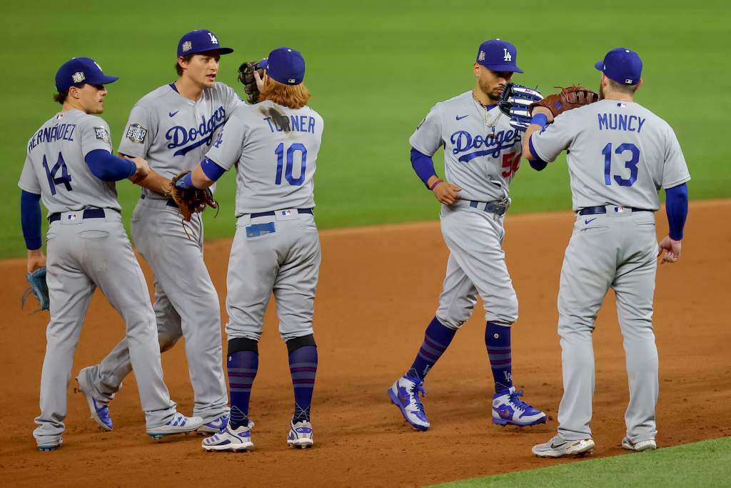 Enrique Hernandez, Corey Seager, Justin Turner, Mookie Betts and Max Muncy of the Los Angeles Dodgers celebrate the teams 4-2 victory against the Tampa Bay Rays in Game Five of the 2020 MLB World Series at Globe Life Field.