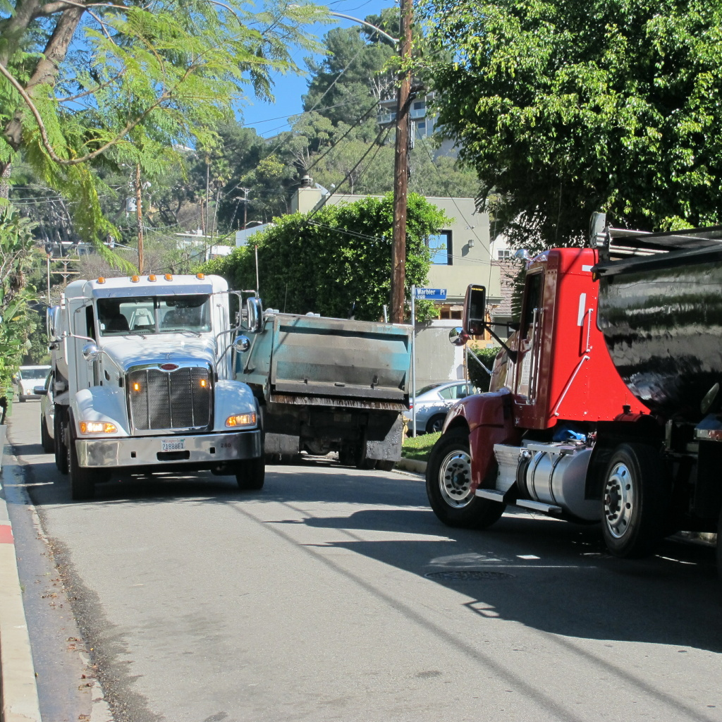 Large trucks hauling dirt from home construction sites in Hollywood Hills have drawn angry complaints from neighbors citing safety issues.