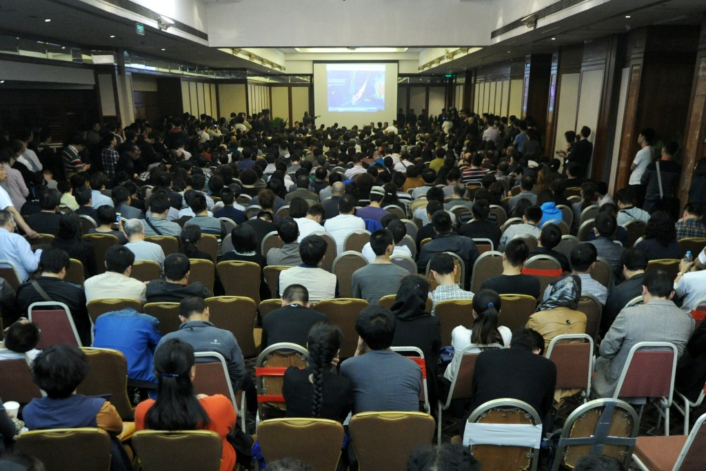 A general view shows relatives of passengers on the missing Malaysia Airlines flight MH370 attending a meeting with delegates from Malaysia at the Metro Park Lido Hotel in Beijing on March 26. Malaysia Airlines told relatives of those on board a jet that crashed in the Indian Ocean that they would be brought to the 'recovery area', as the search goes on for wreckage.