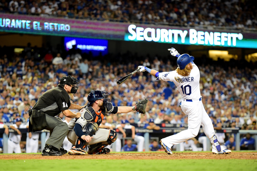 LOS ANGELES, CA - OCTOBER 24:  Justin Turner #10 of the Los Angeles Dodgers hits a two-run home run during the sixth inning against the Houston Astros in game one of the 2017 World Series at Dodger Stadium on October 24, 2017 in Los Angeles, California.  (Photo by Harry How/Getty Images)