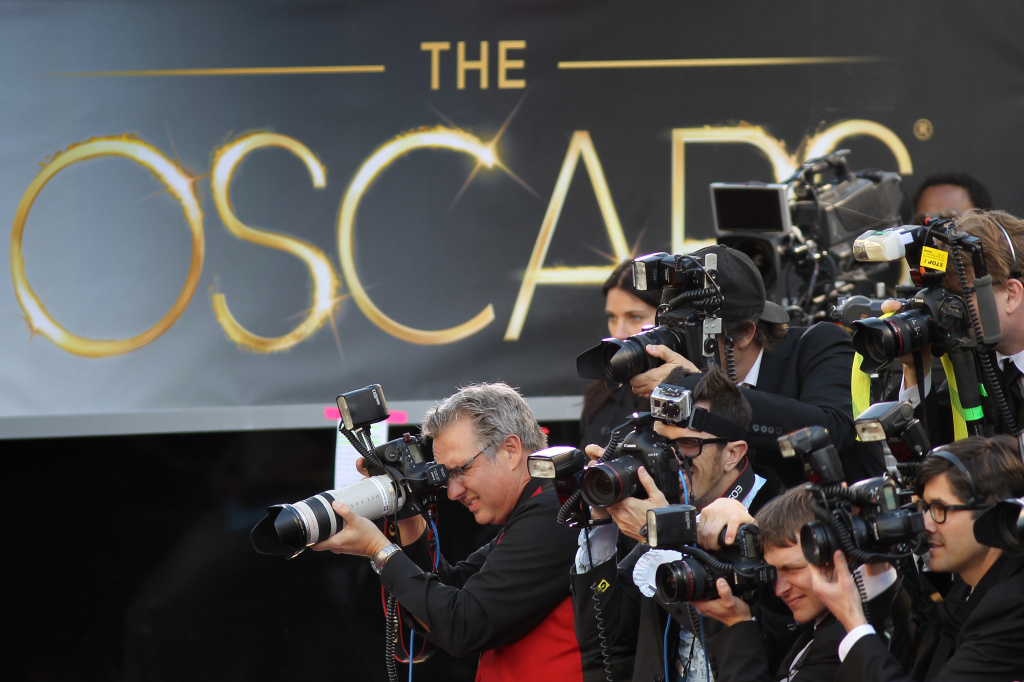 Photographers cover the red carpet arrivals to the 85th Annual Academy Awards at the Hollywood & Highland Center on Feb. 24, 2012 in Hollywood.
