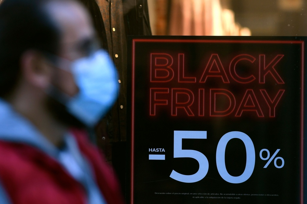 A sign announces a price markdown for Black Friday on the display window of a shop in Madrid on November 23, 2020.