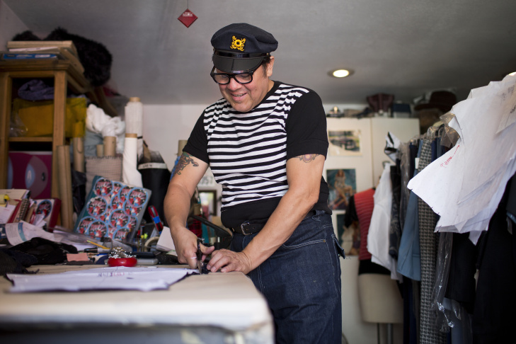 David Contreras is the co-founder of Tarantula Clothing, a 40's and 50's-inspired clothing company based out of Contreras' Boyle Heights garage. He sold out of a tiki-themed storefront on Boyle Avenue during the late 1990s. Contreras cuts a pattern inside his workspace on Wednesday morning, June 25, 2015.