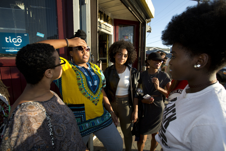 Nyallah Noah, USC student (yellow top) waits in line outside the Black Lives Matter LA performance art show at The Underground Museum Washington Boulevard in Los Angeles on July 8th, 2016.