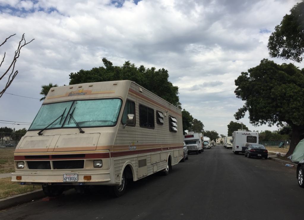 Recreational vehicles and tents line the empty lots of Manchester Square.