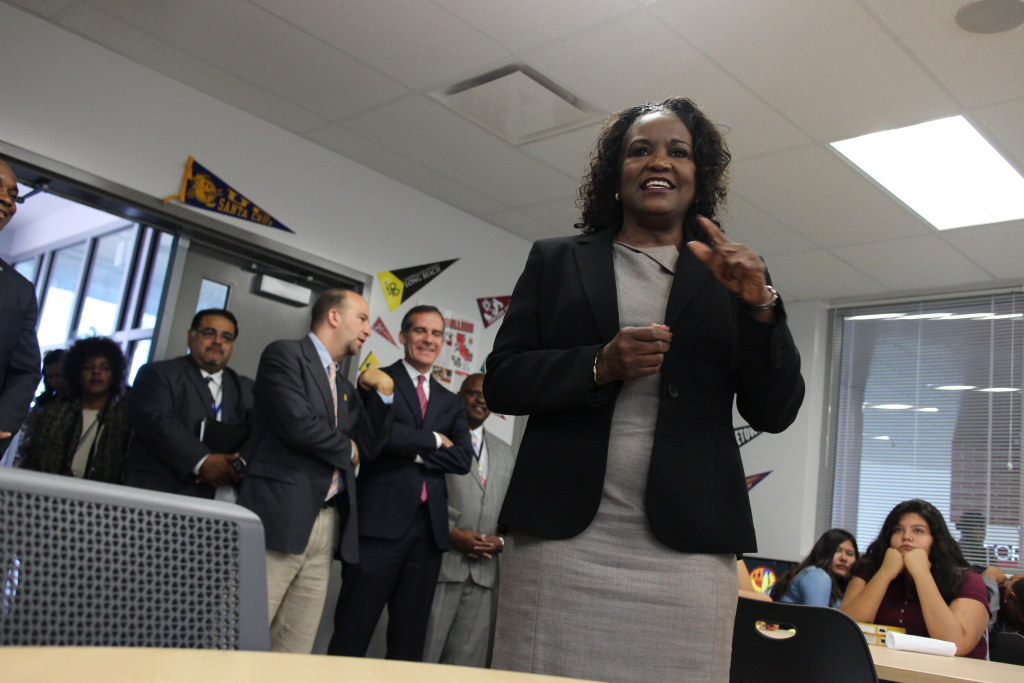 Michelle King, superintendent of the Los Angeles Unified School District, addresses students in a classroom at Fremont High School in South L.A. on Aug. 16, 2016, as Mayor Eric Garcetti (in background) looks on.