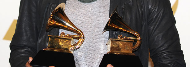 Usher poses with his awards during the 53nd annual Grammy Awards in Los Angeles, California on February 13, 2011.