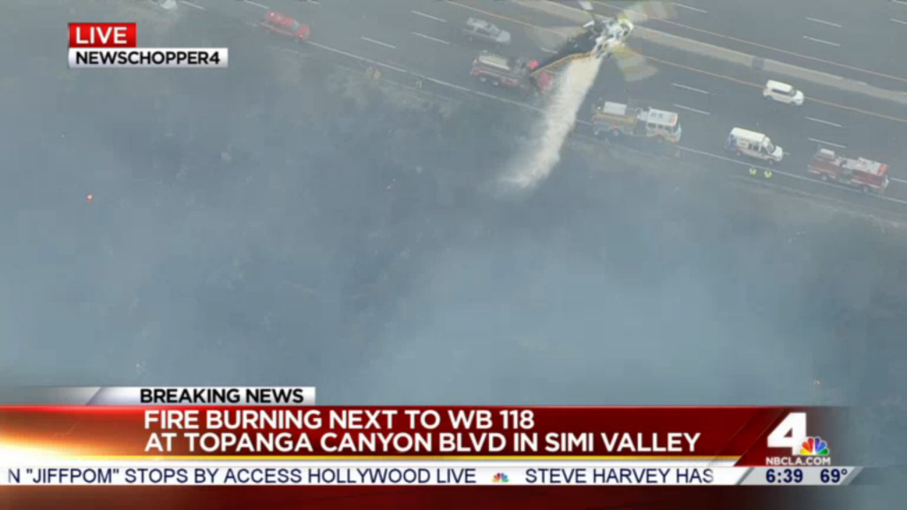 A brush fire broke out next to the 118 Freeway in Simi Valley after a vehicle went over the side of the road on Friday morning, August 14, 2015.