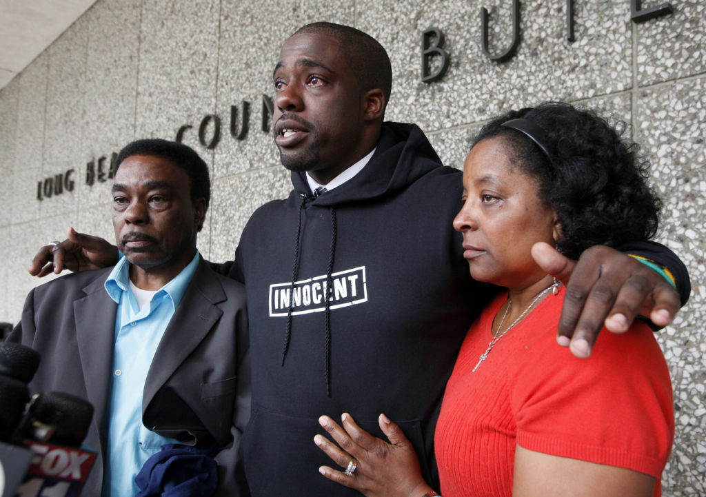 Brian Banks, center, reacts with his mother, Leomia Myers and father, Jonathan Banks, outside court after his rape conviction was dismissed Thursday May 24, 2012 in Long Beach. Banks, a former Long Beach high school football star and prized college recruit who served more than five years in prison for a rape he did not commit had his conviction overturned Thursday with his accuser recanting her story.
