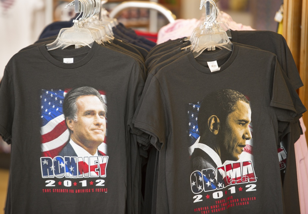 T-shirts bearing the images of Republican presidential candidate Mitt Romney (L) and US President Barack Obama for sale are seen at a retail shop inside Dulles International Airport near Washington, DC, September 17, 2012 in Chantilly, Virginia.