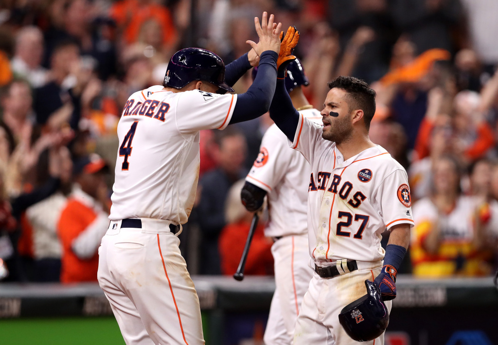 Jose Altuve of the Houston Astros celebrates with George Springer after hitting a three-run home run during the fifth inning against the Los Angeles Dodgers.