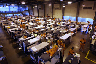Several hundred inmates crowded the gymnasium at San Quentin prison in 2009.