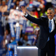US President Barack Obama and Democratic Presidential nominee Hillary Clinton wave to the crowd on the third day of the Democratic National Convention at the Wells Fargo Center, July 27, 2016 in Philadelphia, Pennsylvania.