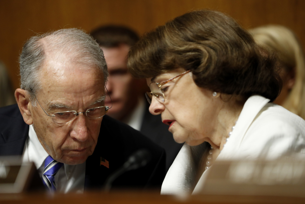 (File photo) Sen. Dianne Feinstein, D-Calif., talks with Sen. Chuck Grassley, R-Iowa, in July 2017.