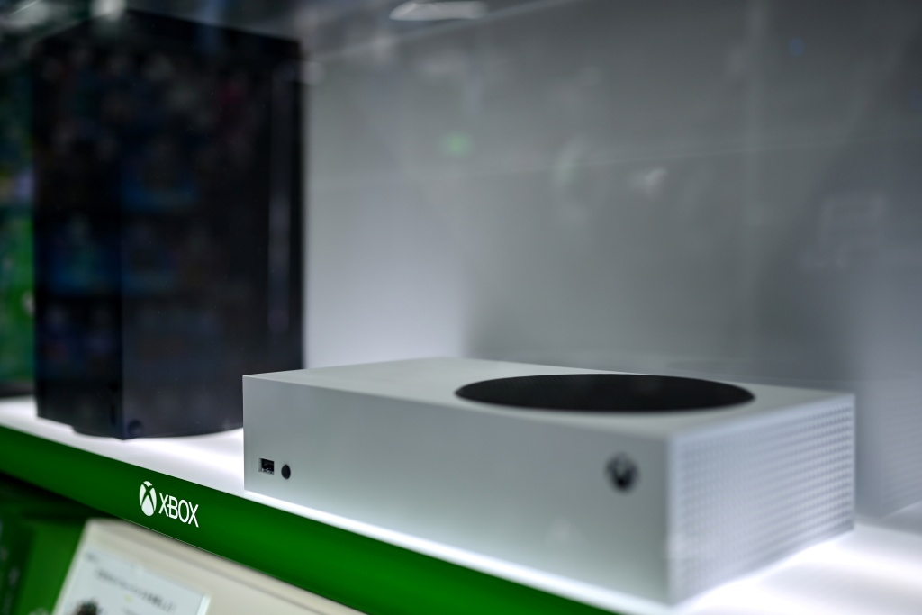 Microsoft's Xbox Series X (L, in black) and series S (R, in white) gaming consoles are seen on display during its worldwide release at an electronics store in Tokyo on November 10, 2020.