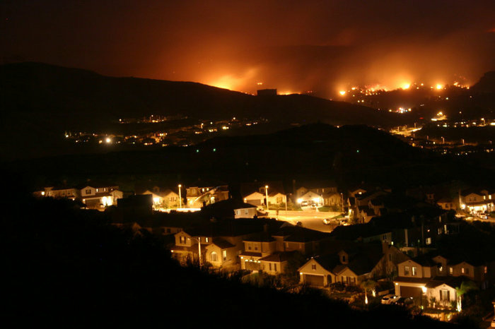 Wildfires burned in the hills of Santa Clarita, Calif., threatening suburban development in October 2007. This fire was among more than a dozen major wildfires, many of which were started from human-related ignitions.