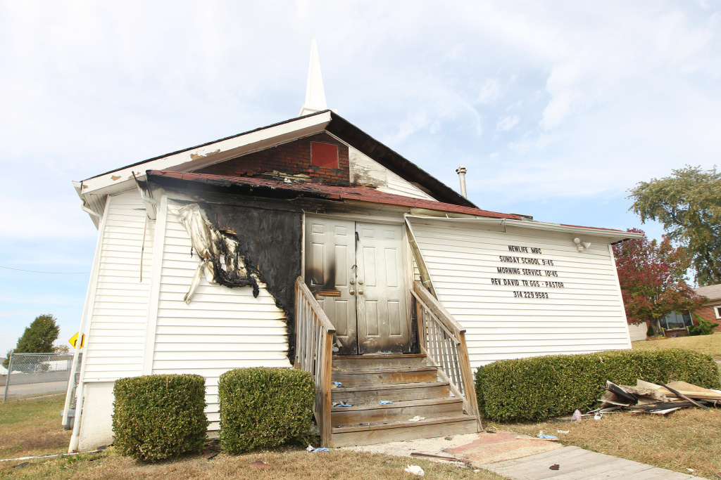 The Newlife Missionary Baptist Church in north St. Louis as it sits with the front burned on Tuesday. A fire damaged the front doors, siding and an entrance to the small predominantly Africian-American church.