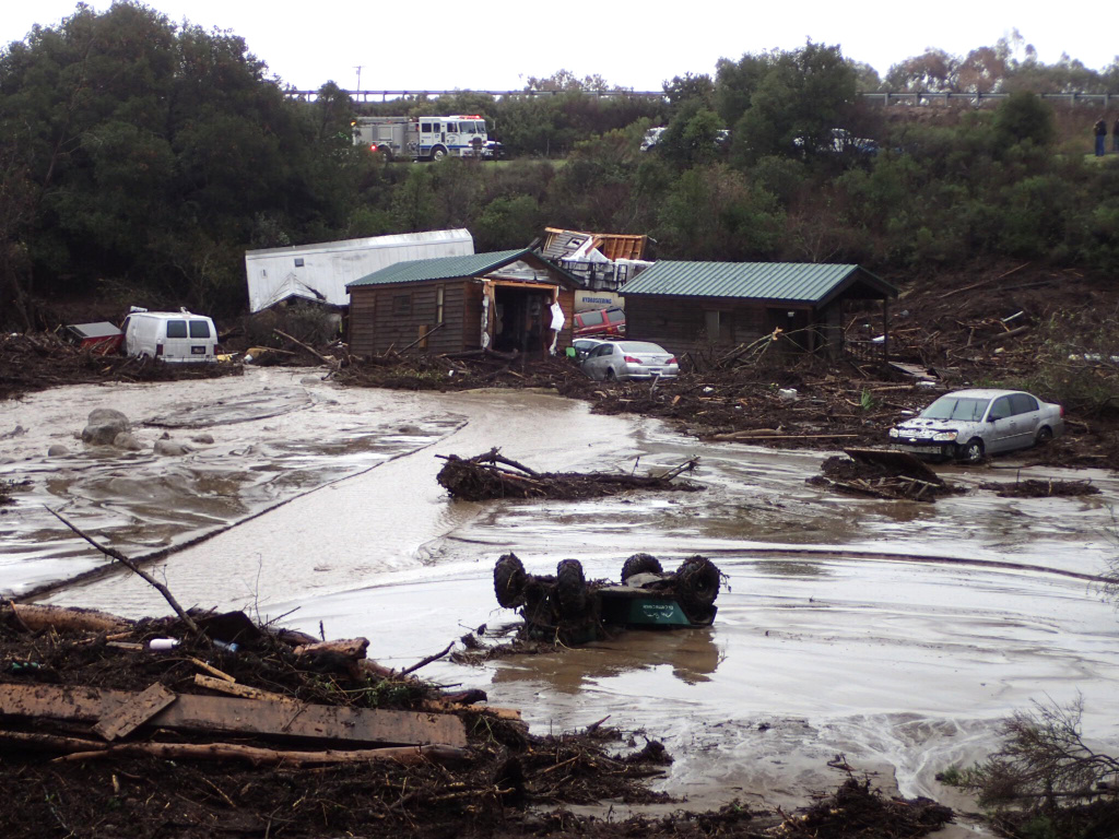 Cabins and vehicles are swept away by storm runoff at El Capitan Canyon Resort & Campground in Gaviota, Calif., on Friday, Jan. 20, 2017. A flood on the southern Santa Barbara County coast has swept cabins and vehicles down a narrow canyon as the latest storm drenches California. County Fire Department Capt. Dave Zaniboni says a creek overflowed at midmorning Friday and swept five cabins and 15 vehicles down the canyon which lies just above El Capitan State Beach. (Mike Eliason/Santa Barbara County Fire Dept. via AP)