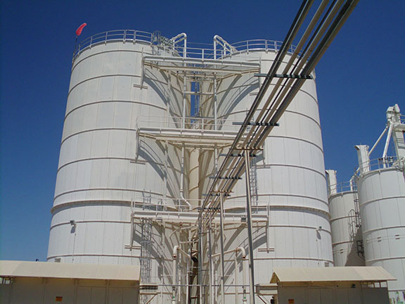 Two large storage tanks at the Yuma Desalting Plant stand a few stories above ground.