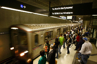 Passengers wait for Metrolink subway trains during rush hour June 3, 2008 in Los Angeles, California.