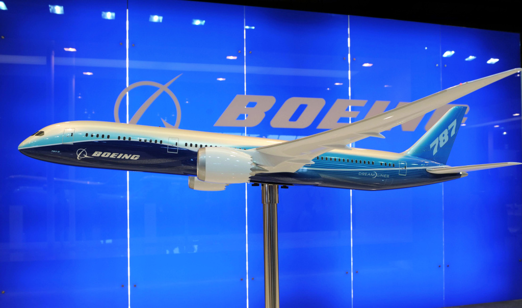 A model display of a Boeing 787 Dreamliner is exibited at the Singapore Airshow in Singapore on February 14, 2012. Boeing and Indonesian carrier Lion Air formally signed a 22.4 billion USD deal for 230 aircraft, the single largest contract in commercial aviation history.