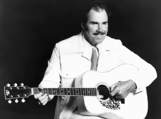 This undated file photo shows country singer Slim Whitman. Whitman died Wednesday, June 12, 2013 of heart failure in Florida. He was 90. Whitman's career began in the late 1940s, and his tenor falsetto and ebony mustache and sideburns became global trademarks. They were also an inspiration for countless jokes thanks to the ubiquitous 1980s and 1990s TV commercials that pitched his records.